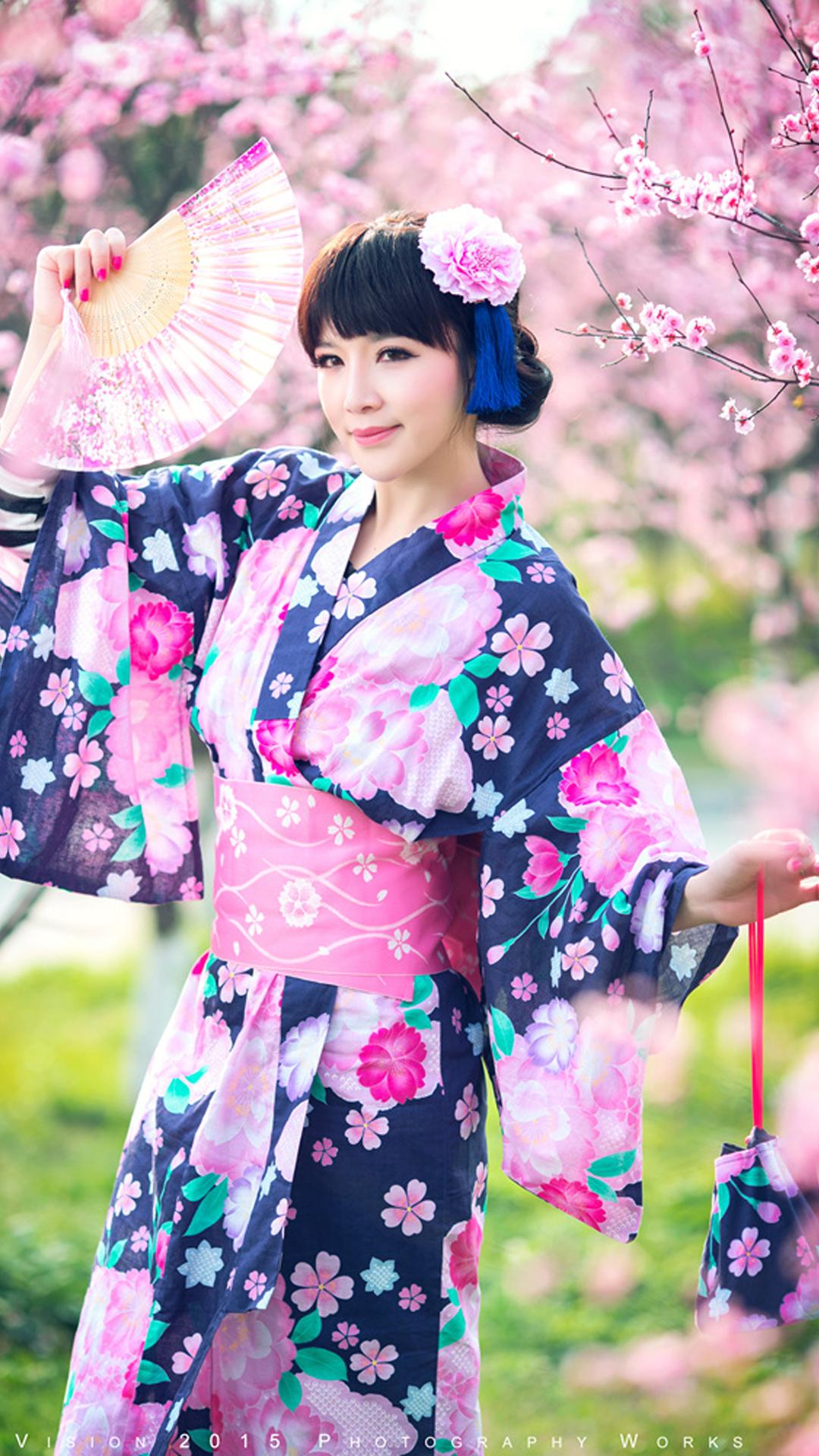 Pretty girl wearing a kimono