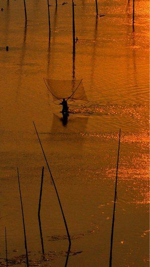 Fishingman on beach