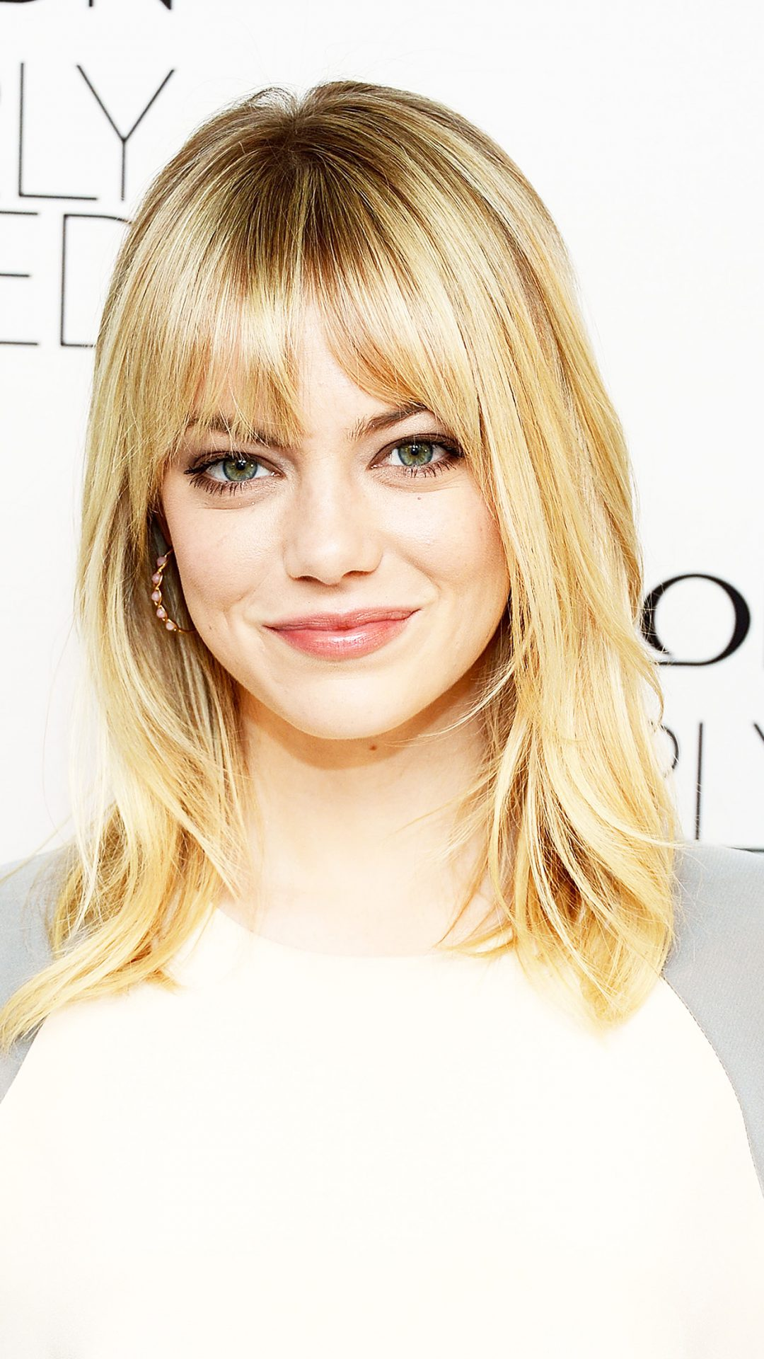 NEW YORK, NY - DECEMBER 05:  Actress Emma Stone attends the Emma Stone Revlon's NEW Nearly Naked Makeup Launch at The London Hotel on December 5, 2012 in New York City.  (Photo by Andrew H. Walker/Getty Images)