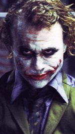 "In this image released by Warner Bros., Heath Ledger starring as The Joker, is shown in a scene from ""The Dark Knight.""   (AP Photo/Warner Bros. Pictures, Stephen Vaughan) ** NO SALES **"